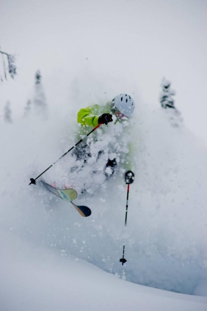 skier going fast through powder